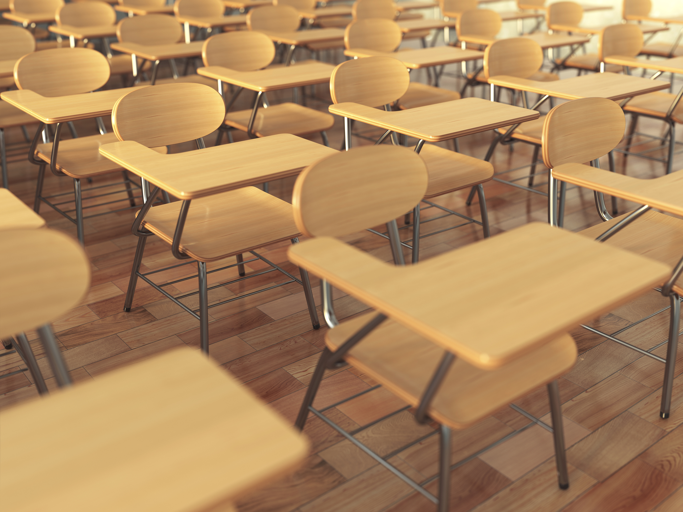 School classroom with empty school chairs and blackboard. Back t