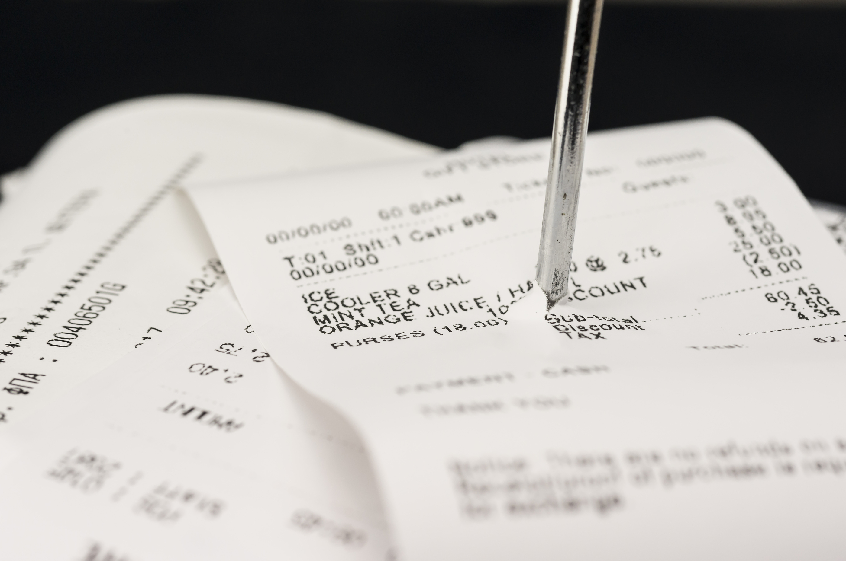 Close up shot of receipts piled up