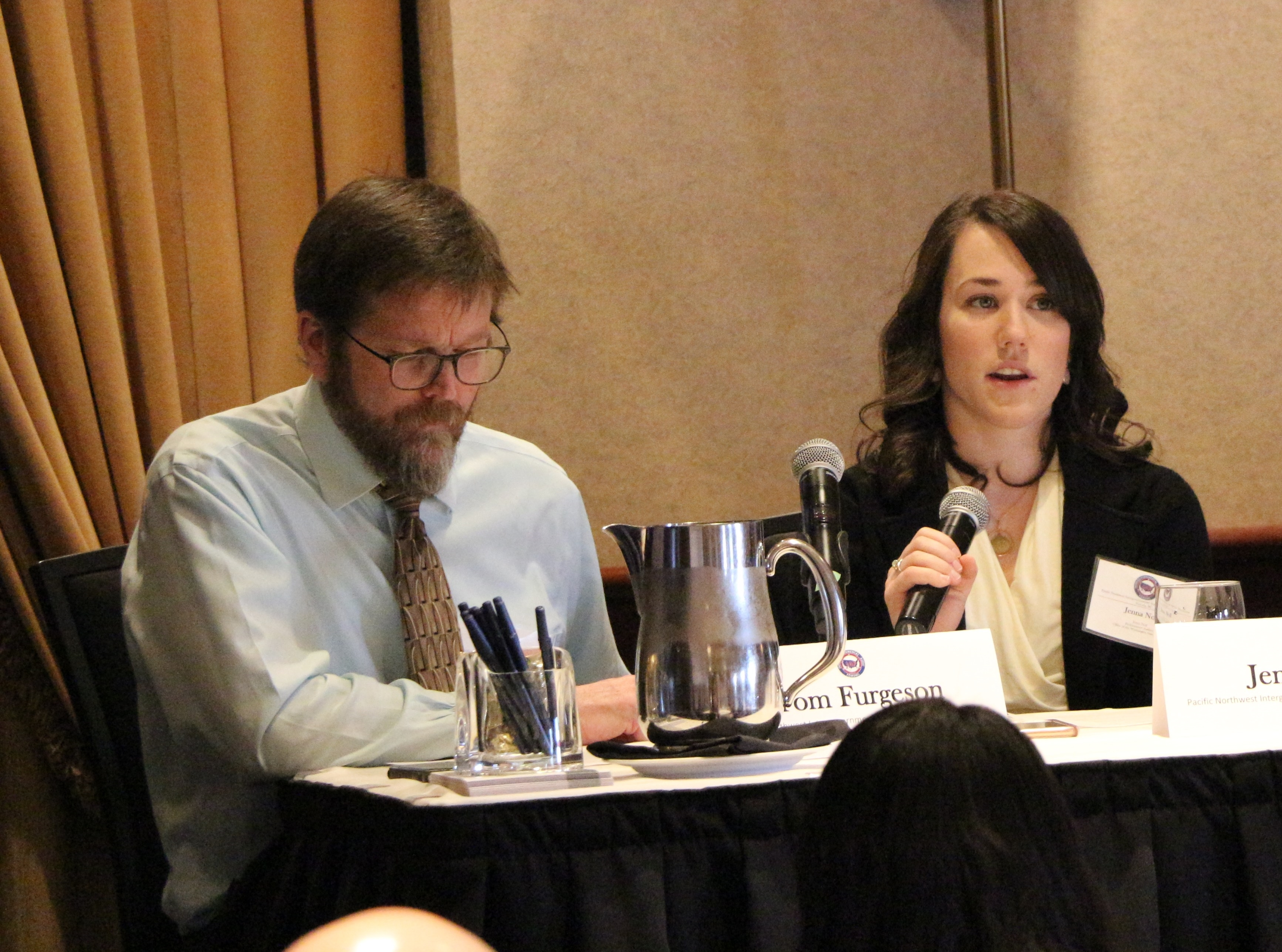 Performance auditor Jenna Noll speaks during a presentation at the Pacific Northwest Intergovernmental Auditors Forum March 16 at Victoria, B.C. Assistant Director for Performance Audit Tom Furgeson is shown at left.