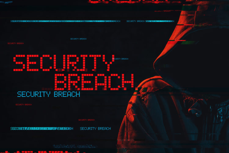 """Hooded figure next to a screen that reads """"Security breach"""""""