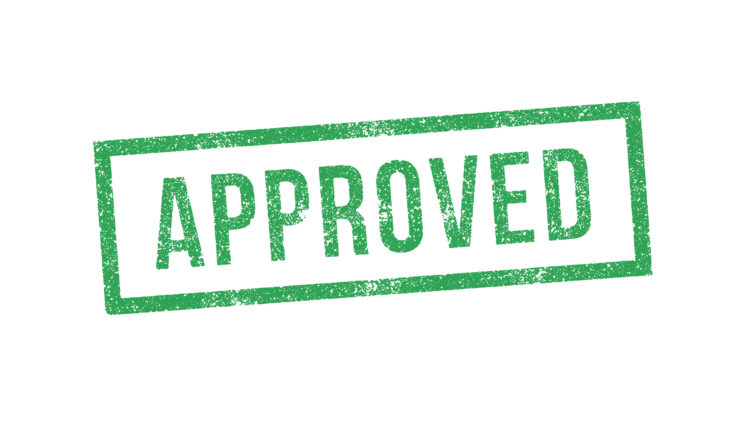 "Green stamp of the word ""approved"""