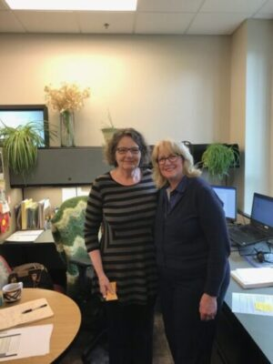 Washington State Auditor Pat McCarthy congratulates Assistant Audit Manager Alexandra Johnson on 28 years of service at the Office of the Washington State Auditor. Johnson is retiring Oct. 1.