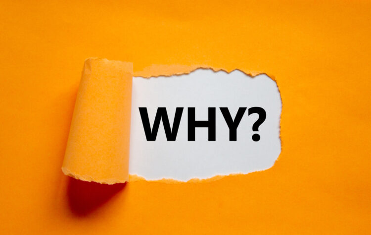 "The word ""Why?"" appearing behind torn orange paper,"